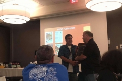 Gerald Griffin Presents Jim Valenzuela with a Publication Award.